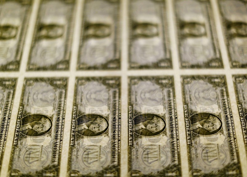 FILE PHOTO: FILE PHOTO: United States one dollar bills seen on a light table at the Bureau of Engraving and Printing in Washington