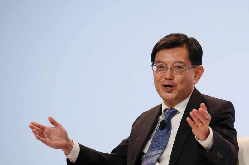 FILE PHOTO: Singapore's Finance Minister Heng Swee Keat speaks at a UBS client conference in Singapore
