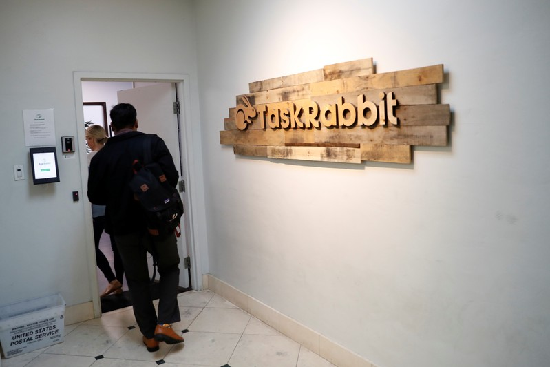 Workers enter the TaskRabbit office in San Francisco, California