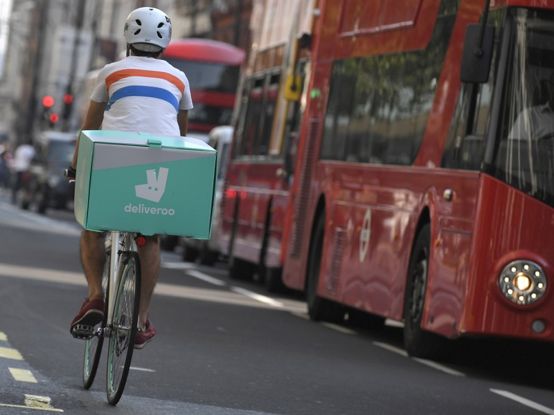 FILE PHOTO: A cyclist delivers food for Deliveroo in London, Britain