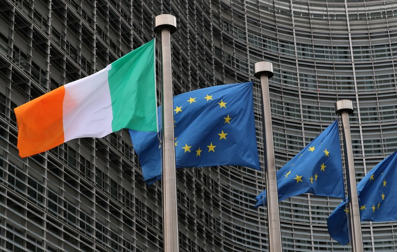 Irish and European flags fly outside the European Commission headquarters in Brussels