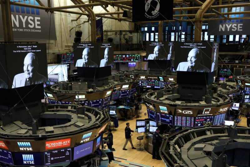 FILE PHOTO: Screens display a tribute to Jack Bogle, founder and retired CEO of The Vanguard Group, on the floor of the NYSE in New York