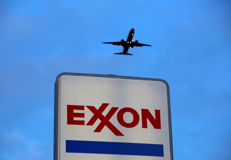 FILE PHOTO: An airplane comes in for a landing above an Exxon sign at a gas station in the Chicago suburb of Norridge