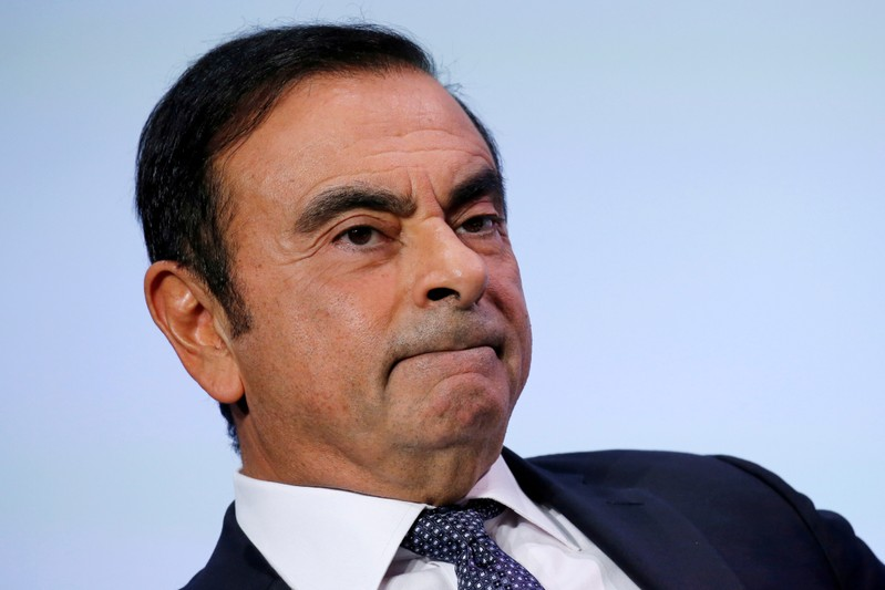FILE PHOTO: Carlos Ghosn, chairman and CEO of the Renault-Nissan-Mitsubishi Alliance, attends at the Tomorrow In Motion event on the eve of press day at the Paris Auto Show, in Paris
