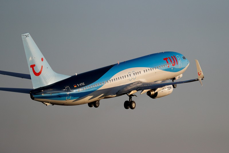 FILE PHOTO: A TUI fly Boeing 737 airplane takes off from the airport in Palma de Mallorca