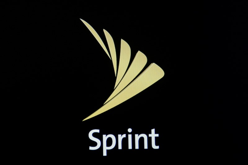 The Sprint logo is displayed on a a screen on the floor of the NYSE in New York City