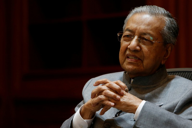 FILE PHOTO - Malaysia's Prime Minister Mahathir Mohamad speaks during an interview with Reuters in Putrajaya