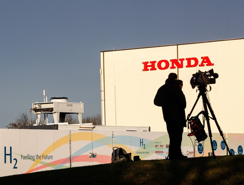 Members of media stand outside the Honda car plant in Swindon