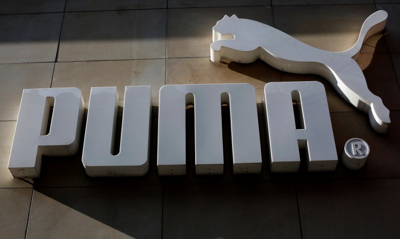 The logo of German sports goods firm Puma is seen at the entrance of one of its stores in Vienna