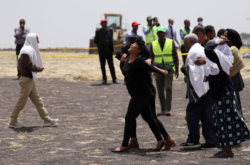 FILE PHOTO: A relative mourns at the scene of the Ethiopian Airlines Flight ET 302 plane crash, near the town Bishoftu