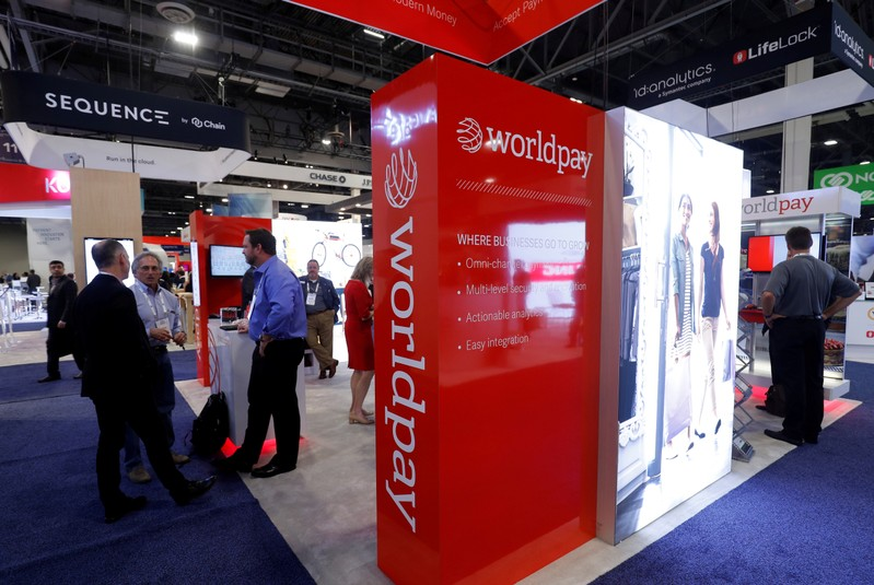 FILE PHOTO: A Worldpay booth is shown on the exhibit hall floor during the Money 20/20 conference in Las Vegas