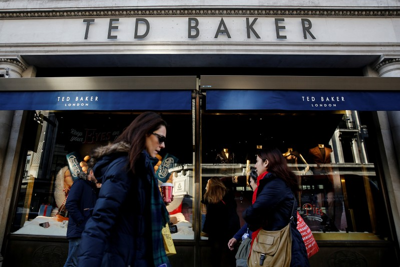 e9b44c1a66f803 FILE PHOTO  Shoppers walk past a Ted Baker store on Regents Street in London
