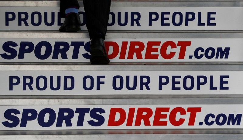 A man arrives for Sports Direct AGM at their headquarters in Shirebrook