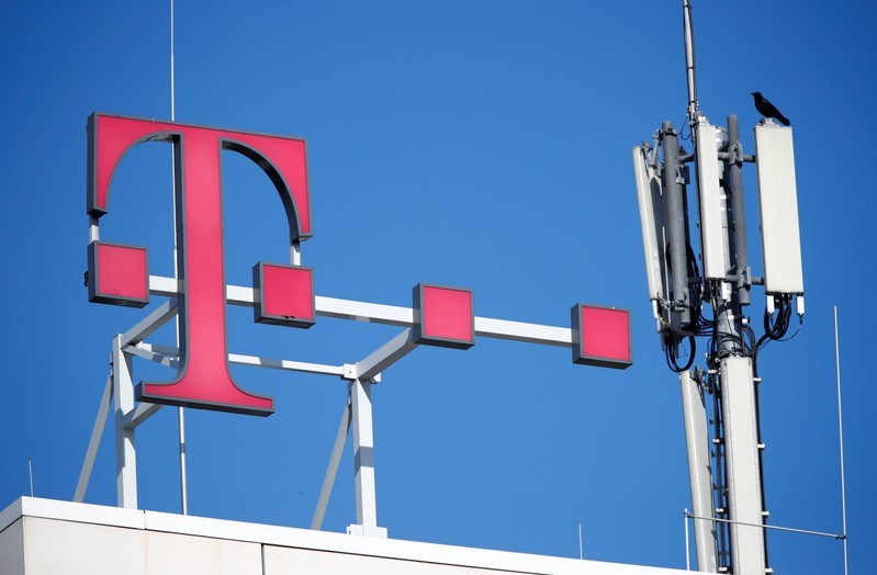 Logo of German telecommunications giant Deutsche Telekom AG and GSM and antennas are seen atop of the headquarters of Deutsche Telekom in Bonn