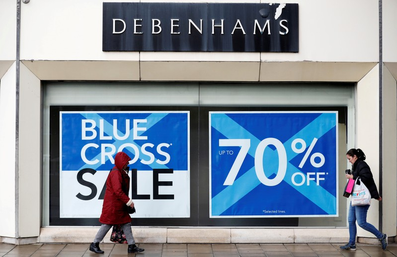FILE PHOTO: People walk past a Debenhams store in Stockport