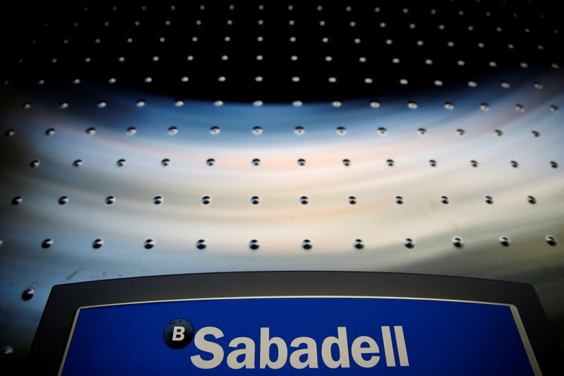 FILE PHOTO: Sabadell bank's logo is seen at an ATM machine outside one of the bank's branches in Madrid