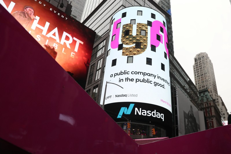 Signage for Lyft is seen displayed at the NASDAQ MarketSite in Times Square in celebration of its initial public offering (IPO) on the NASDAQ Stock Market in New York
