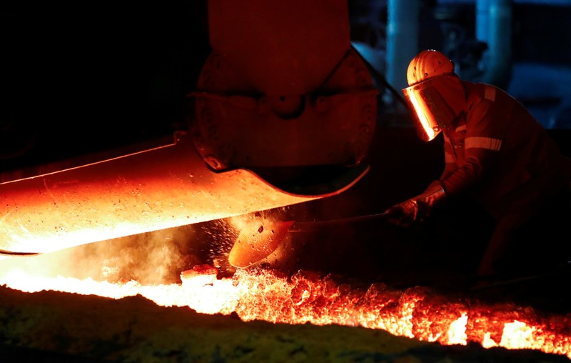 FILE PHOTO: A steel worker of Germany's industrial conglomerate ThyssenKrupp AG works near a blast furnace at Germany's largest steel factory in Duisburg