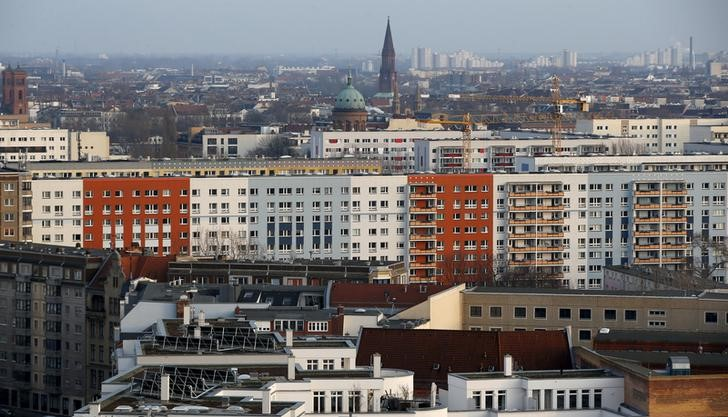 Apartment buildings with the Saint Michael church (C) are pictured at Berlin's Kreuzberg district
