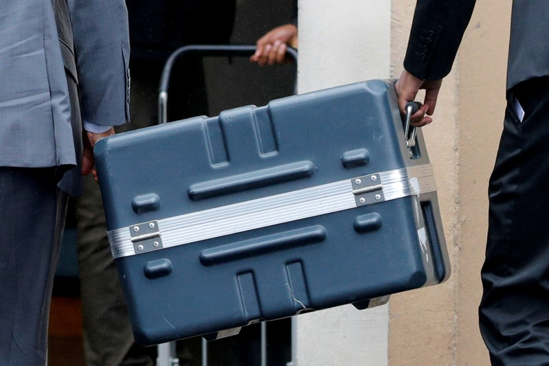 FILE PHOTO - Men unload a case containing the black boxes from the crashed Ethiopian Airlines Boeing 737 MAX 8 outside the headquarters of France's BEA air accident investigation agency in Le Bourget