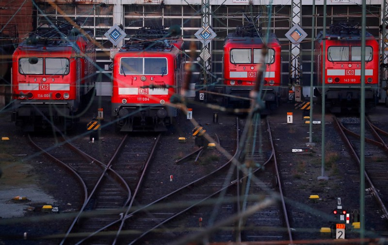 FILE PHOTO: Trains of German railway Deutsche Bahn are seen at the main train station in Frankfurt