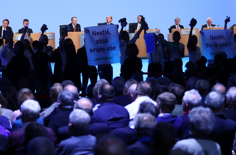 Greenpeace activists demonstrate against plastic usage during the 152nd Annual General Meeting of Nestle in Lausanne