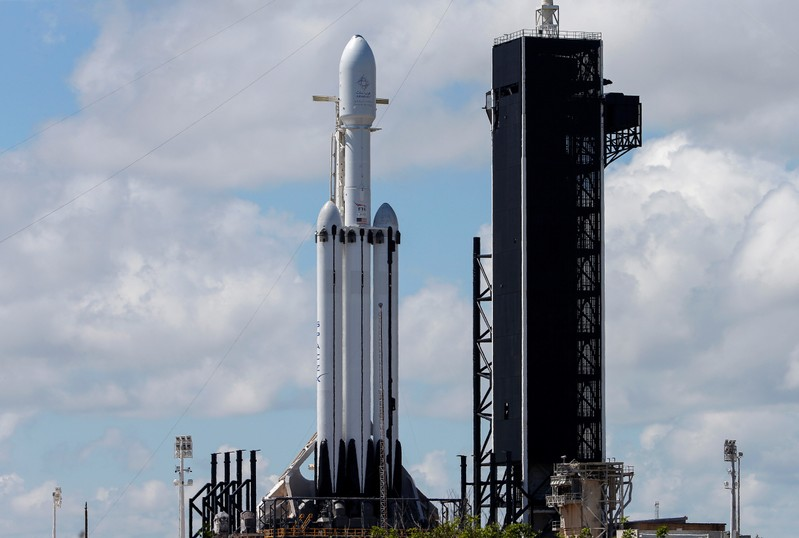A SpaceX Falcon Heavy rocket with the Arabsat 6A communications satellite aboard is prepared for launch at the Kennedy Space Center in Cape Canaveral