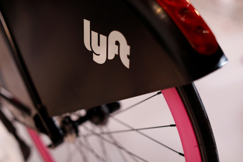 FILE PHOTO: A Lyft bicycle is shown at the Lyft listing on the Nasdaq during an IPO event in Los Angeles