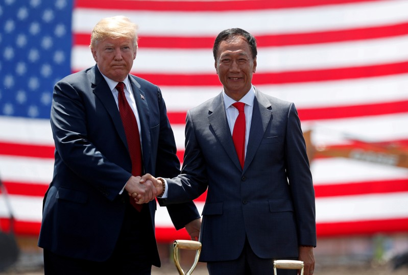 FILE PHOTO:  U.S. President Donald Trump shakes hands with Foxconn Chairman Terry Gou during a grond breaking at Foxconn's new site in Mount Pleasant