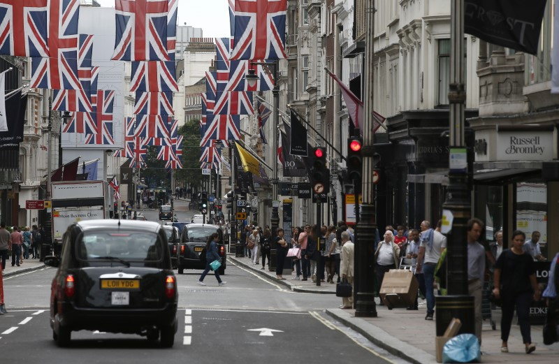File photo of shoppers walking past stores on New Bond Street in London
