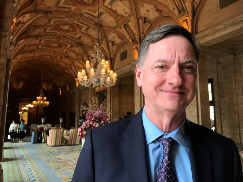 FILE PHOTO: Charles Evans, president of the Federal Reserve Bank of Chicago, poses for a photo in Palm Beach