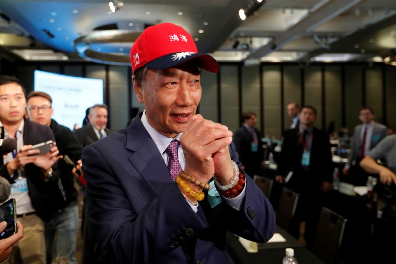 Terry Gou, founder and chairman of Foxconn, greets during an event that marks the 40th anniversary of the Taiwan Relations Act, in Taipei