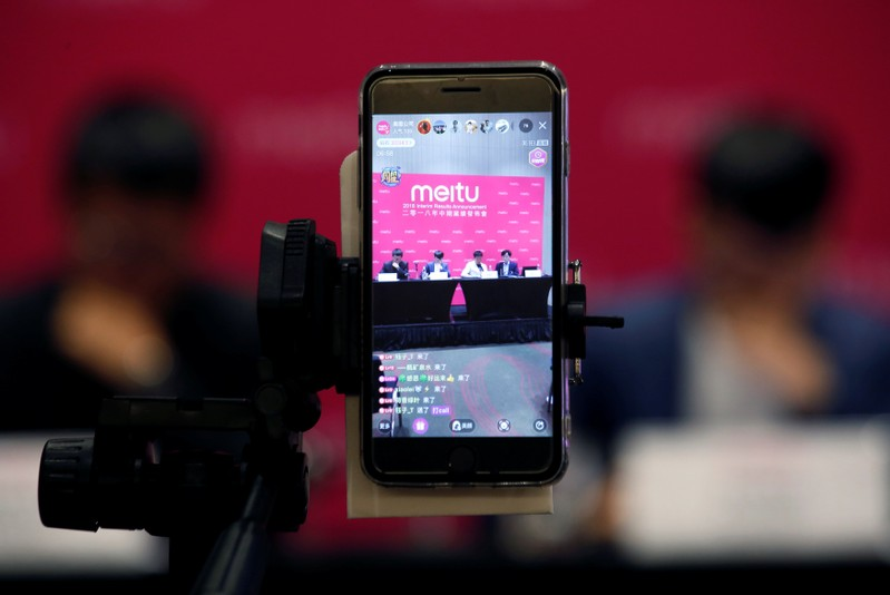 A smartphone transmits a live stream of the news conference of Meitu Inc in Hong Kong