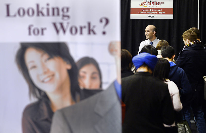 People wait in line for resume critique and career assessment sessions at 2014 Spring National Job Fair and Training Expo in Toronto