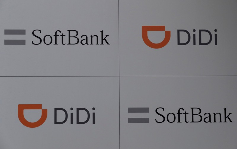 The logos of Didi Chuxing and SoftBank are pictured during a news conference about their Japanese taxi-hailing joint venture in Tokyo