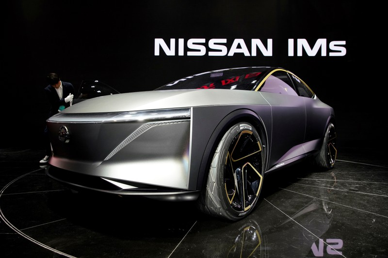 Man cleans a Nissan IMs concept car displayed during the media day for the Shanghai auto show in Shanghai