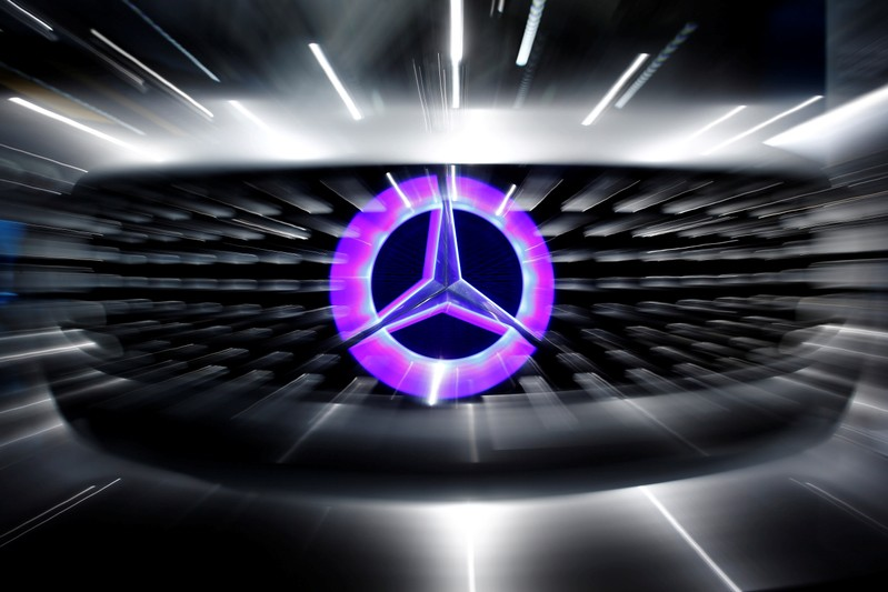 FILE PHOTO: An illuminated logo of Mercedes is seen on the Mercedes-Benz F105 at an exhibition before the Daimler annual shareholder meeting in Berlin