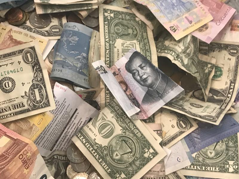 Dollar flat as market awaits U S -China trade news