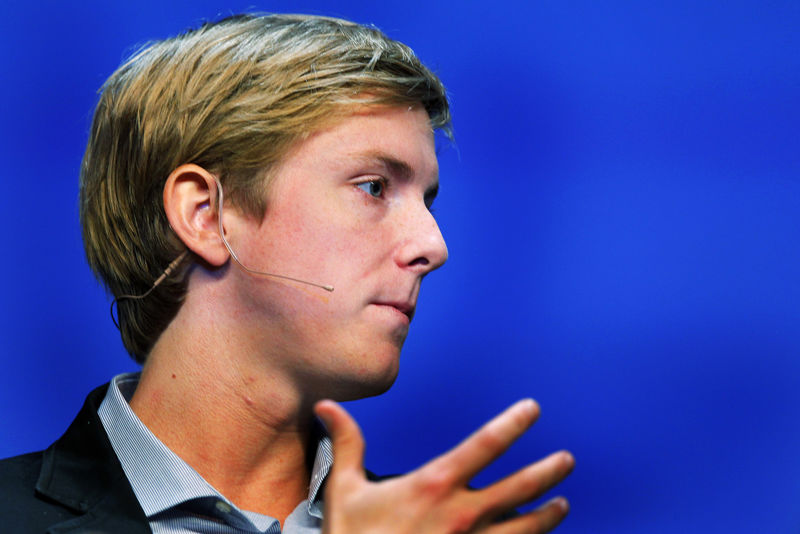 FILE PHOTO: Chris Hughes, co-founder of Facebook, speaks at the Charles Schwab IMPACT 2010 conference in Boston
