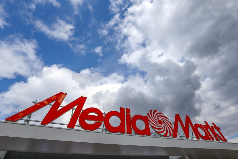 The logo of the electronics retailer Media Markt is seen at the entrance of a shop in Sint-Pieters-Leeuw