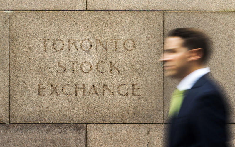 FILE PHOTO: A man walks past an old Toronto Stock Exchange sign in Toronto