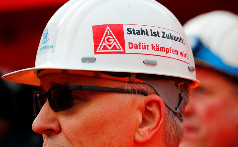 Workers of German steel maker ThyssenKrupp AG protest in a warning strike organised by German union IG Metall for higher wages at the ThyssenKrupp steel Europe plant of Dortmund
