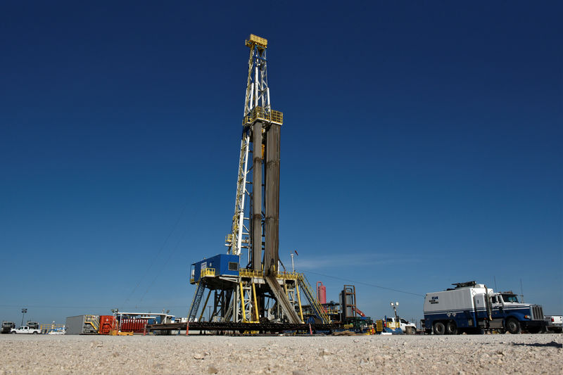 FILE PHOTO: A drilling rig on a lease owned by Oasis Petroleum performs logging operations in the Permian Basin near Wink