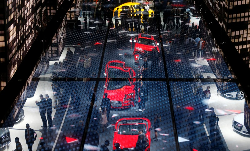 The stand of German car manufacturer Audi is reflected in the ceiling during a media preview day at the Frankfurt Motor Show (IAA)