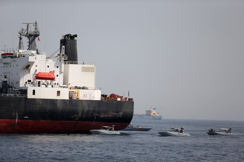 FILE PHOTO:  UAE Navy boats are seen next to Al Marzoqah, Saudi Arabian tanker, off the Port of Fujairah