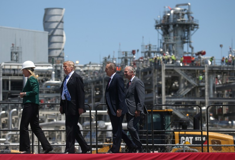 U.S. President Trump walks with Sempra management at Cameron LNG Export Facility in Hackberry, Louisiana
