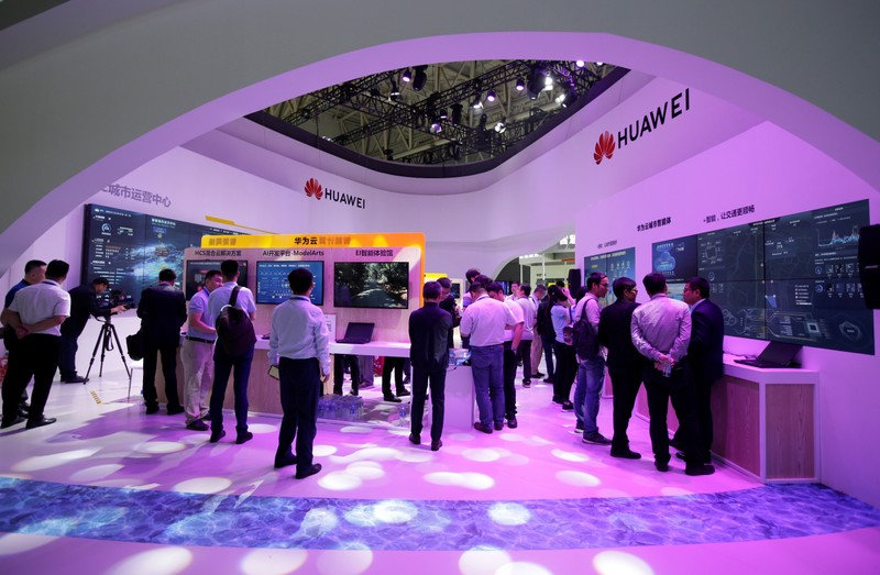 People visit Huawei's booth at an exhibition during the World Intelligence Congress in Tianjin
