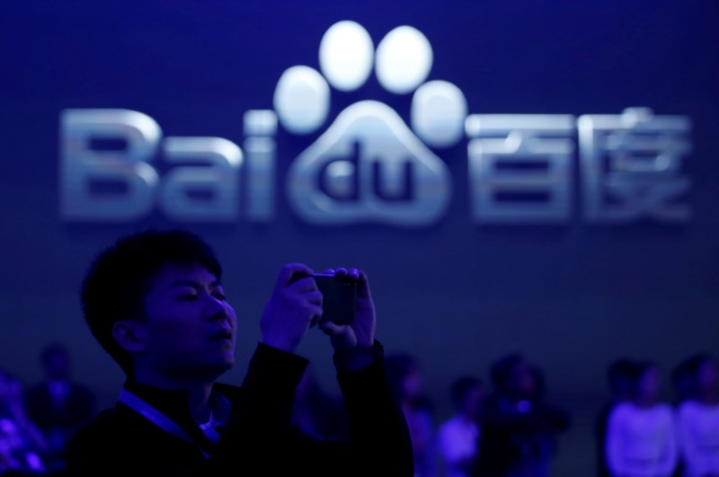 FILE PHOTO: A man takes pictures at the 2018 Baidu World conference and exhibit in Beijing
