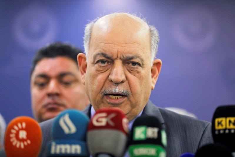 FILE PHOTO: Iraqi Oil Minister Thamer Ghadhban speaks to the media at the ministry's headquarters in Baghdad