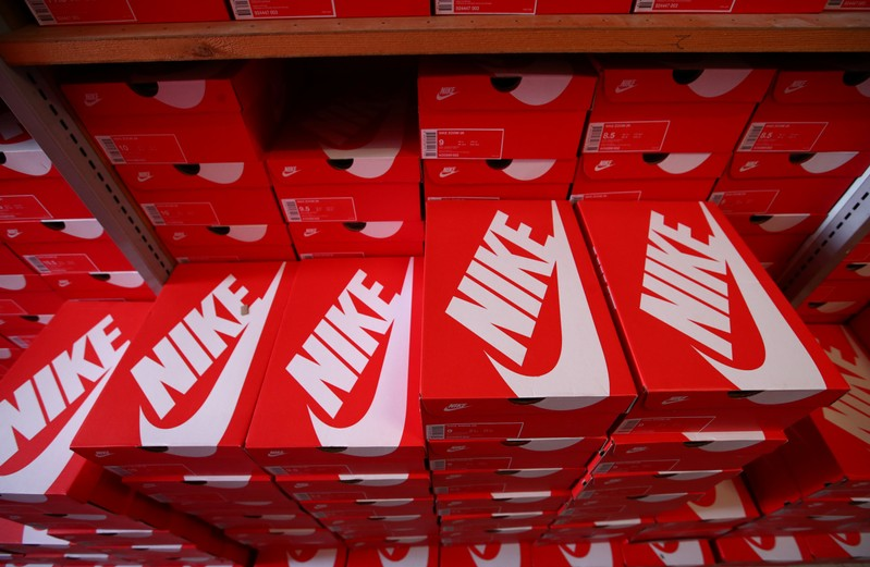 Boxes of Nike shoes are pictured in the warehouse of local footwear retailer